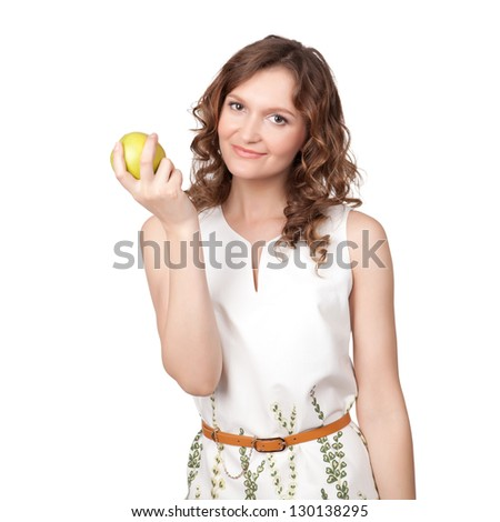 Portrait of an attractive young woman with an apple against white background