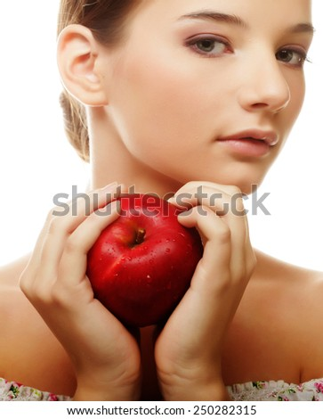 Portrait of an attractive young woman with an apple against white background - stock photo