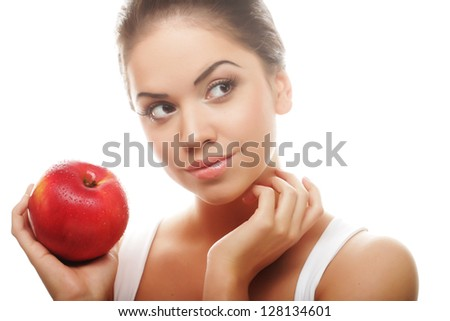 Portrait of an attractive young woman with an apple ahainst white background