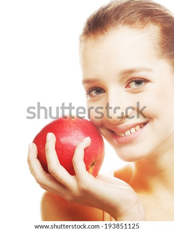 Portrait of an attractive young woman with an apple ahainst white background - stock photo