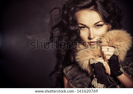 Portrait of an attractive young woman with curly brunette hair.  - stock photo
