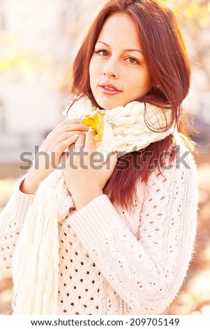 Portrait of an autumn smiling woman with leaves  - stock photo