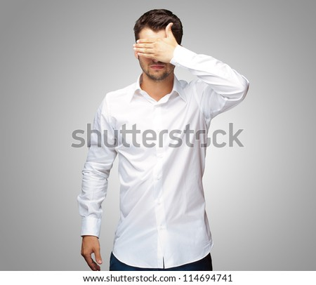 Portrait Of An Businessman Covering Eyes Isolated On Grey Background