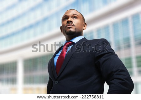 Portrait of an businessman in front of his office - stock photo