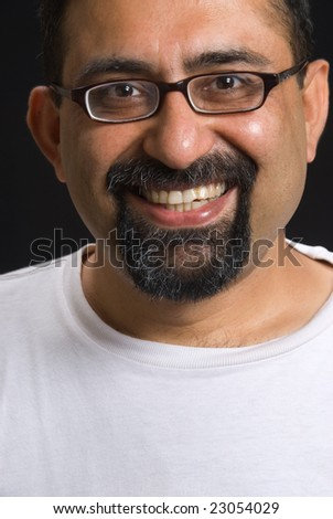 Portrait of an East Indian man wearing a white t-shirt