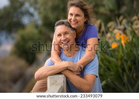 Portrait of an elder couple holding hands - stock photo