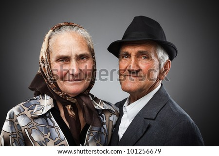 Portrait of an elderly couple in studio - stock photo