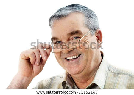 Portrait of an elderly man looking at camera and smiling - stock photo