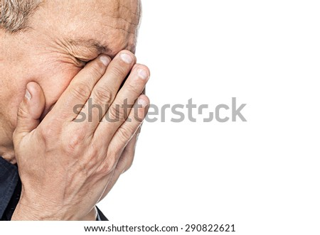 Portrait of an elderly man with face closed by hand isolated on white background with copy-space