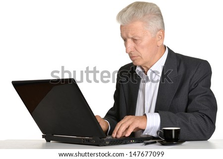 portrait of an elderly man working with a laptop on a white background