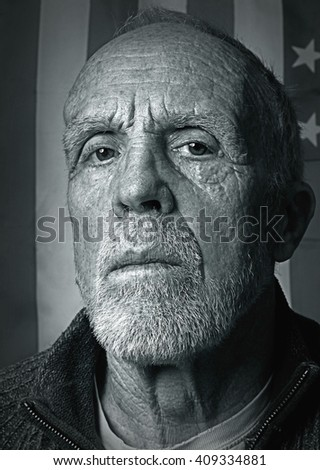 Portrait of an Elderly Vet in front of an American Flag