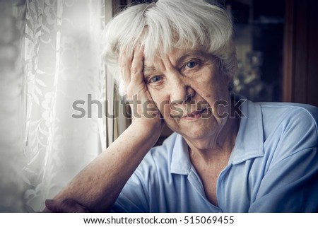 Portrait of an elderly woman at the window