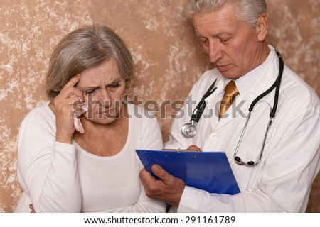 Portrait  of an elderly woman came to the doctor - stock photo