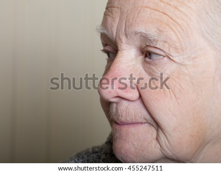 Portrait of an elderly woman. Closeup view.