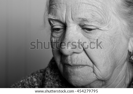 Portrait of an elderly woman. Closeup view. Toned. - stock photo