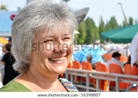 Portrait of an elderly woman, his eyes set forward,smiling - stock photo