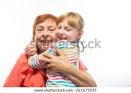 portrait of an elderly woman hugging a little girl - stock photo