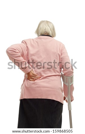 Portrait of an elderly woman touching her back on isolated background - stock photo