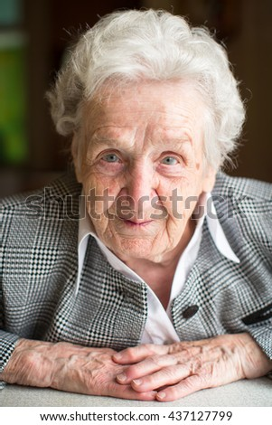 Portrait of an elderly woman with gray hair. - stock photo