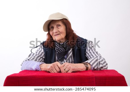 Portrait of an elderly woman with happy face expression. - stock photo