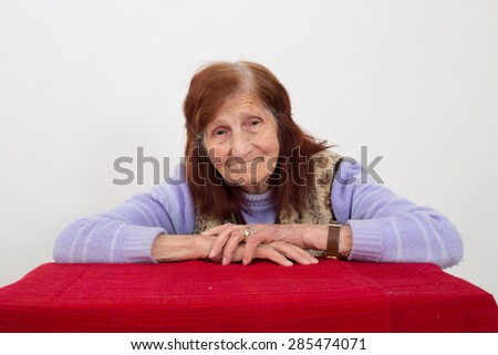Portrait of an elderly woman with satisfied face expression. - stock photo