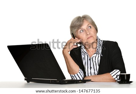 Portrait of an elderly woman working with a laptop on a white background