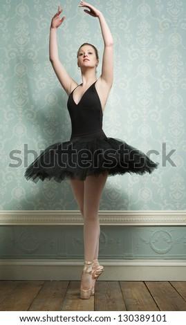 Portrait of an elegant ballerina in dance pose - stock photo