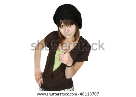 Portrait of an elegant brunette woman in black beret pointing at the camera , white background