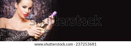 Portrait of an elegant festive brunette in sequin dress. - stock photo