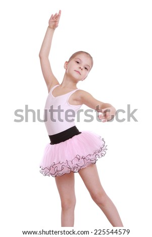 Portrait of an elegant little ballerina in a pink tutu dancing classic ballet isolated on white - stock photo