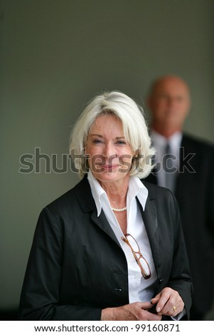 Portrait of an elegant senior woman - stock photo
