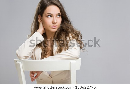 Portrait of an elegant thoughtful young businesswoman. - stock photo