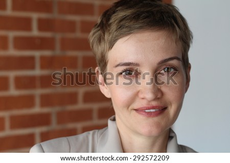Portrait of an elegant woman with short hair - stock photo