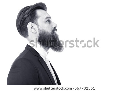 Portrait of an elegant young fashion man with beard and mustache over white