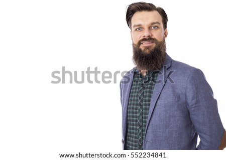 Portrait of an elegant young fashion man with beard and mustache posing. Studio shot