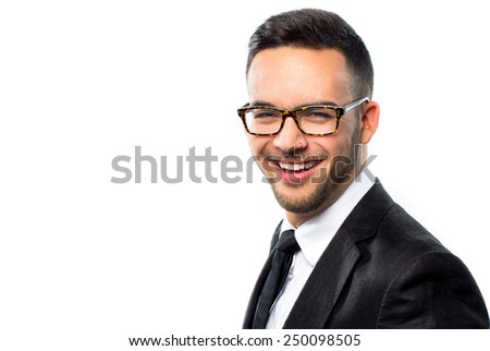 Portrait of an elegant young man wearing glasses - stock photo