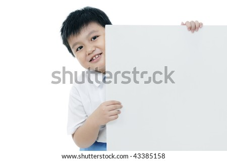 Portrait of an elementary schoolboy holding a blank card over white background.