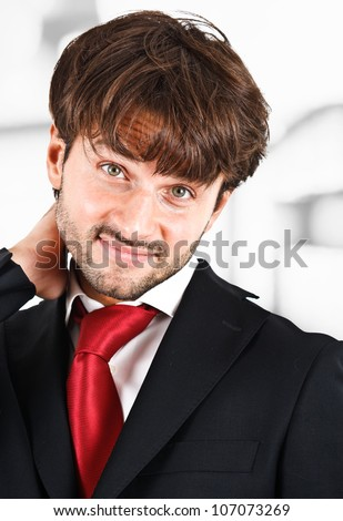 Portrait of an embarrassed businessman - stock photo