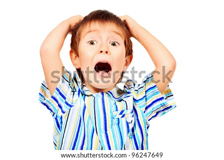 Portrait of an emotional 5 year boy. Isolated over white background. - stock photo