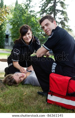 Portrait of an EMS team responding to a call - stock photo