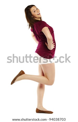 Portrait of an energetic young woman posing over white background