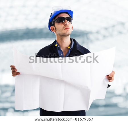 Portrait of an engineer at a construction site - stock photo