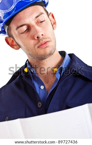 Portrait of an engineer looking at a scheme - stock photo