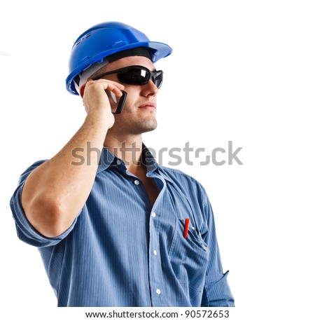 Portrait of an engineer using a cellphone. Isolated on white - stock photo