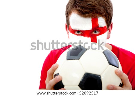 Portrait of an english football fan with his face painted and holding the ball - isolated - stock photo
