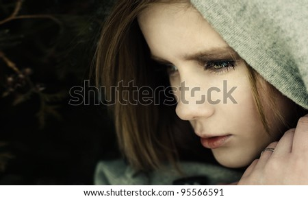 portrait of an enigmatic young woman - stock photo
