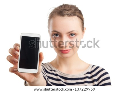 Portrait of an European blond woman in her twenties, showing a white mobile phone. Focus on phone, face blurred. Isolated on white background. - stock photo