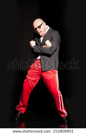 portrait of an evil man. cool man with glasses - stock photo