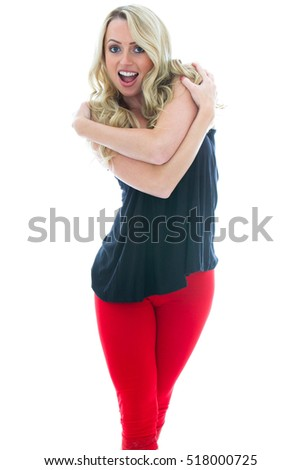 Portrait of an Excited Girl Laughing and Hugging Herself Against a White Background