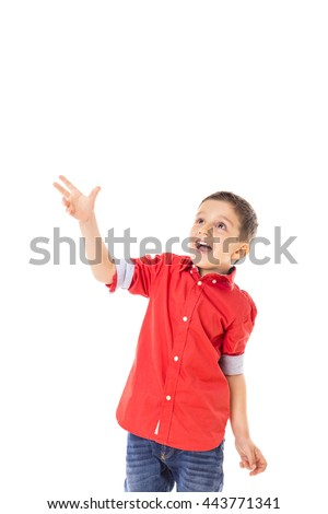 Portrait of an excited  little boy playing over white background